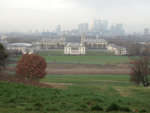 The Old Royal Naval College, with the remains of the Olympic Equestrian venue in the foreground, and Canary Wharf (London's newer financial district) in the background.